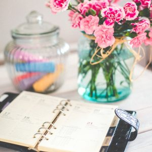 Fresh flowers and an updated calendar keep the feng shui new year energy fresh in your office.